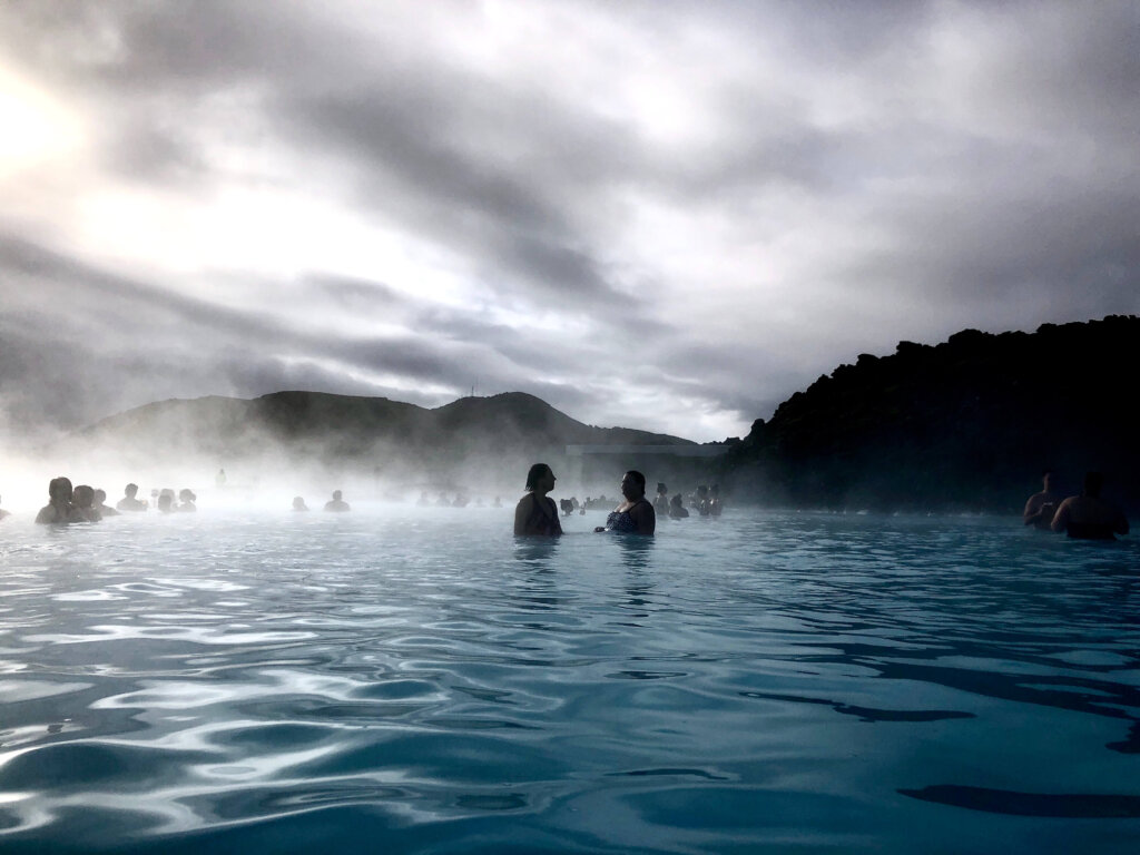 View from inside the Blue Lagoon with steam rising from the water.