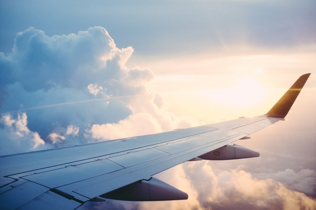 View of the sky from inside an airplane. Long haul flight essentials for your travel checklist.